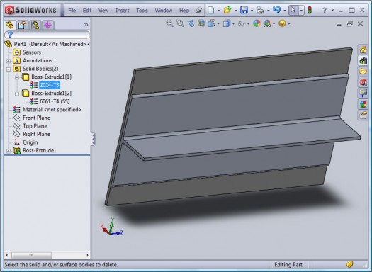 This part has one Extruded feature. Two profiles were sketched which created two separate bodies. In SolidWorks 2010 a separate material can now be applied to each body.