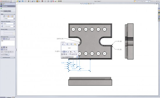 Look at that. Those dimensions were auto-arranged using the new options in the SolidWorks 2011 Dimension Pallet. (Click to Enlarge)