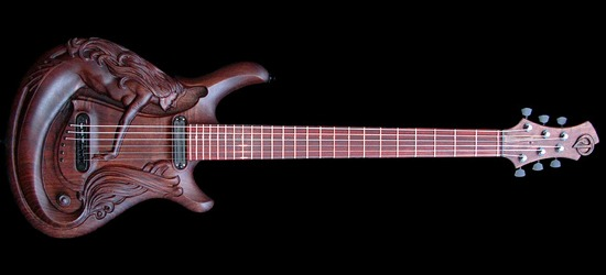 Yes a mermaid adorns this incredible hand carved guitar