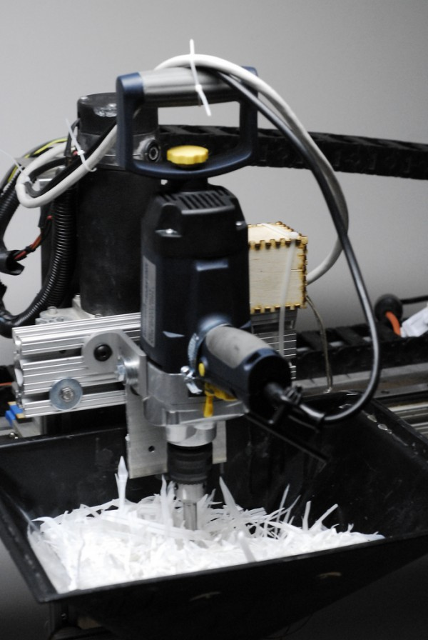 Nom nom nom! Big Robot eats milk bottle scraps and extrudes a fine bead of plastic.