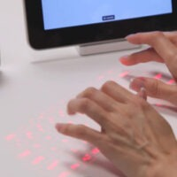 Magic Cube Projects Full-Size Laser Keyboard Onto Your Desktop