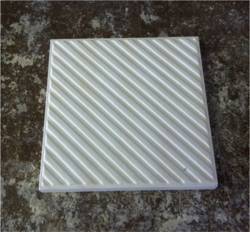 A ceramic plaster positive mold of the tile