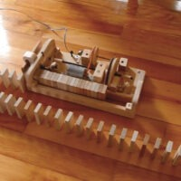 This Wooden Domino Row Building Machine Just Might Be the Best Thing Ever