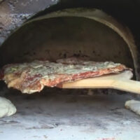 This Wood Fired Pizza Oven Was Made Using a Pilates Ball