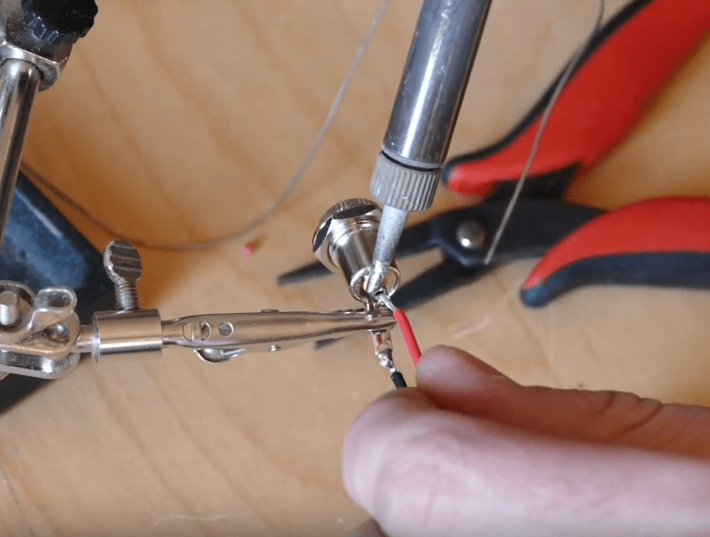 Solder wires to power jack.