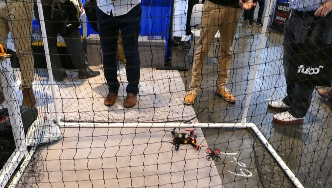 Beagle Drones' mini TechDay New York Thunderdome for drone racing display. Two drones enter...
