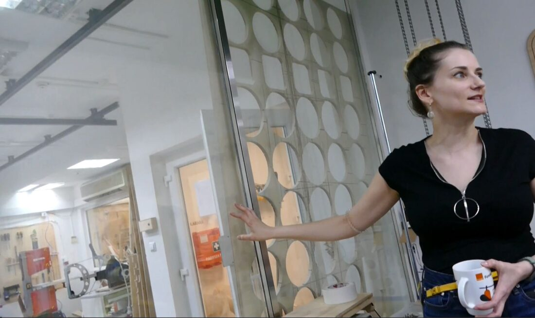 Zaras shows off the old film studio sound-absorbing walls in the tour of the FabLab Powered by Orange.