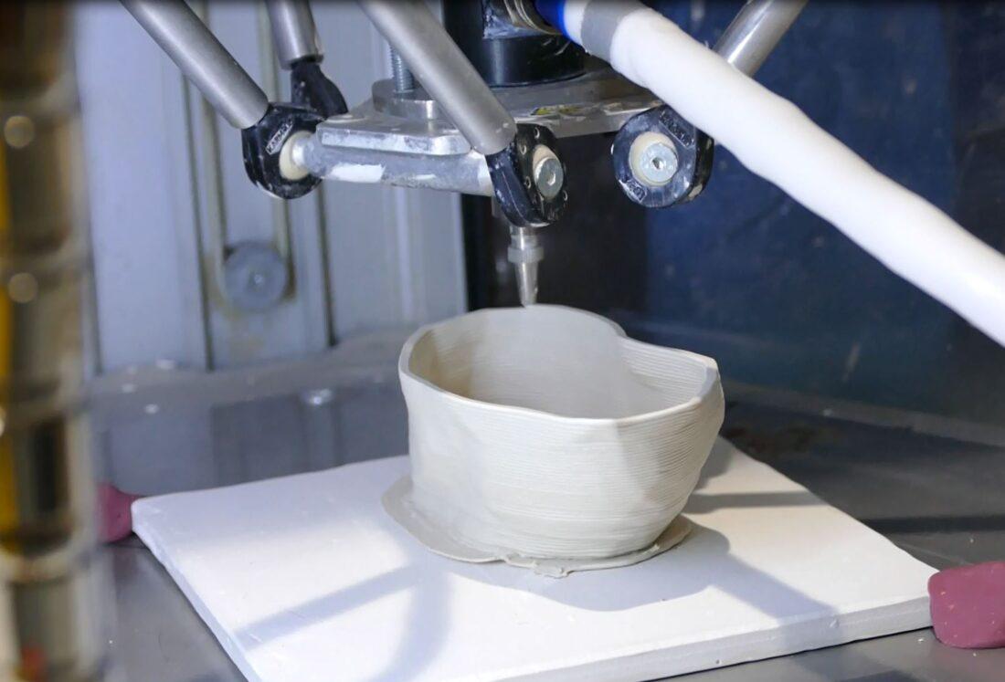 Ceramic 3D printer at Fabricator in Kiev, Ukraine, dispensing layers of wet ceramic slurry.