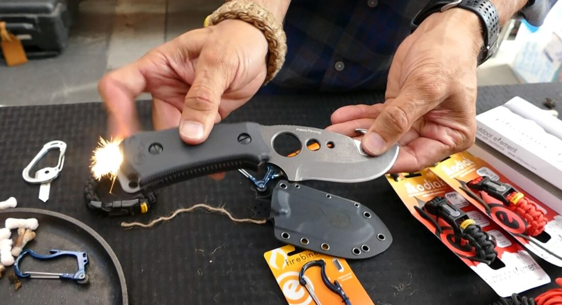 This hunting survival knife has a flint wheel built into it and an inside storage space for tinder.