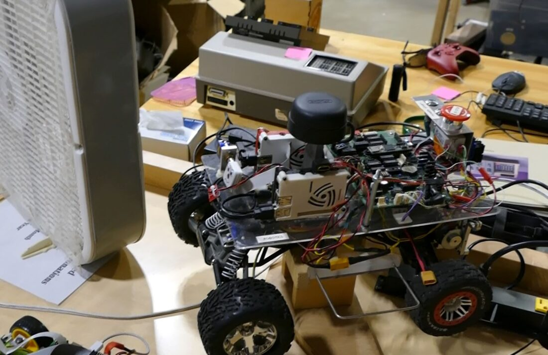One of the DIY self-driving cars built in the electronics lab at TinkerMill to race on the course across the street.