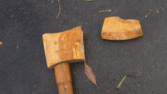 wooden axe out of tree stump